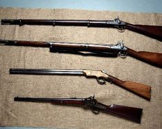 collection of civil war rifles.