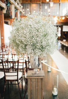Big impact with tiny flowers. Baby's breath wedding decor and mercury glass.   Loves Me Flowers