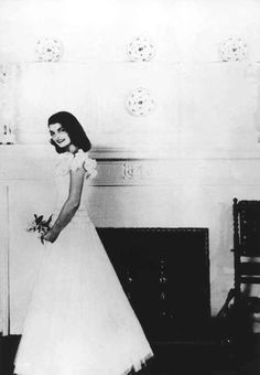 Jackie poses in front of the dining room fireplace at Hammersmith Farm before a dance. She bought her dress for $59 at a New York department store ❤❁♛❤✾❤✾❤❁❤❃❤❁♛❤❁  http://en.wikipedia.org/wiki/Jacqueline_Kennedy_Onassis