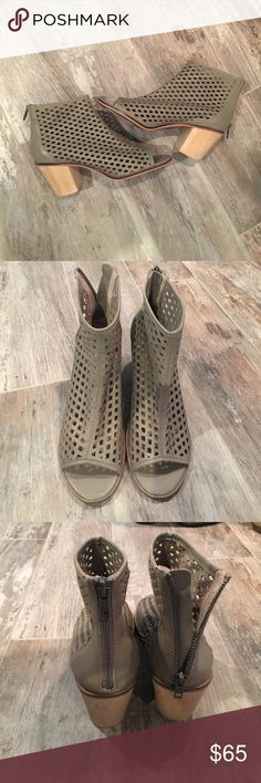 Kelsi Dagger booties Perforated leather with back zipper.  They call this their gray leather but it has a bit of a tan/ brown gray look.  Super comfy and ready to be worn!  They are new!  But have little wear on bottoms from being tried on and walked in store with! Kelsi Dagger Shoes Ankle Boots & Booties