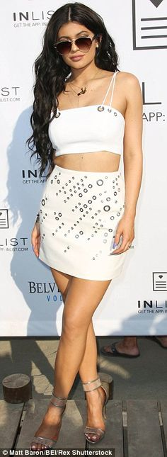 Kylie Jenner dazzles in two outfits before serenade at birthday bash #dailymail