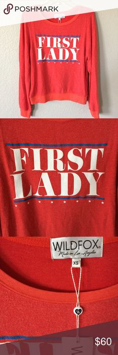 """Wildfox """"First Lady"""" red pullover Sassy statement pullover from Wildfox!  Size XS, but fits larger, as the brand does.  Tag does not state price. Wildfox Tops Sweatshirts & Hoodies"""