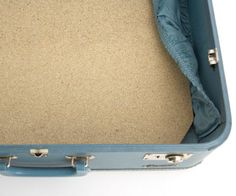 From your local hardware store, pick up a piece of particleboard or MDF. You can either have them cut it to fit the dimensions of the inside of your suitcase, or you can cut at home with a jigsaw. You'll need to angle the corners as shown, as most hard-sided suitcases have rounded edges.