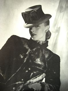 """This Rose Valois' topper of red felt banded with wide black grosgrain fashioned into a bow in the front was featured in a fashion spread called """"Straightforward Paris Hats"""" from the 1939 Vogue Autumn Forecast issue for furs and hats. Photo by Horst."""