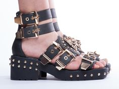 Just because you're near the water doesn't mean give up your edge. These JC kickers with gold buckle make casual a serious choice.  Jeffrey Campbell Mynt in Black Washed Gold at Solestruck.com