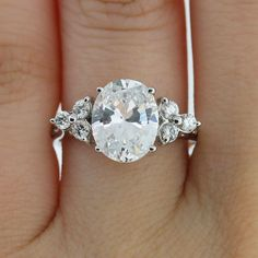 Oval engagement ring with accent diamonds
