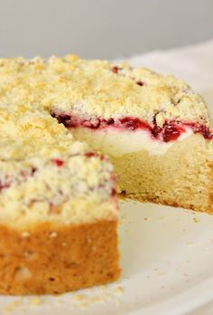 Strawberry Cream Cheese Coffee Cake--It's got a moist buttery cake, thick cream cheese filling, sweet jam made from fresh strawberries, and a nice crumb topping. What could possibly be better than this? It IS the PERFECT coffee cake!