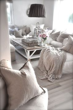 Love the grey livingroom with the pink flowers accent