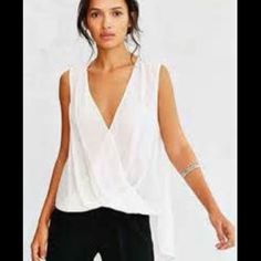 Urban Outfitters white drapey tank Silence and Noise brand from Urban Outfitters cool white drapey tank. Size small worn once!! Urban Outfitters Tops Tank Tops
