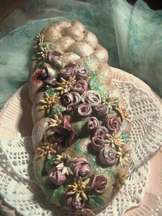 Decorated bread.  Dough flowers and embellishments, cooked then painted with food coloring.  Beautiful!