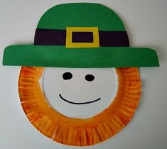 Easy paper plate St Pattys project  supplies you will need:    Paper plate  Orange paint  Paint brush  Scissors  Glue  Green, black and yellow construction paper  Black crayon or markerm