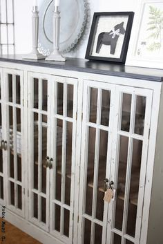 Lovely old bookcase with glass doors. Like the hardware too.