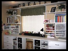 long wall workstation with drawers and wall storage