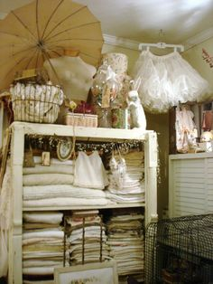 love all of the shabby chicness...old linens, petticoats, etc.