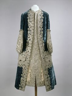 Coat and waistcoat worn by Peter II, 1727–1730 made in France.  Silk velvet and silk taffeta with silver embroidery    The heavy, mono-chrome embroidery is typical of Russian costume during this time.  The large cuffs are really more baroque than rococo.