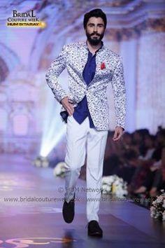 """AMIR ADNAN BRIDAL COLLECTION AT BRIDAL COUTURE WEEK GOLD '16 Representing threads of history and monarchy, Amir Adnan is showcasing his """"Ceremony Collection"""" at Bridal Couture Week 2016. The collection encapsulates statement jackets and sherwanis paired with Jodhpur-eque pajamas and gathered, tucked and rumpled luxurious shalwars. The collection is a tasteful ode to classical tailoring and royal romance that is communicated through its bright game of tones. Amir Adnan's coll... Mens Sherwani, Wedding Dress Men, Pakistani Bridal Dresses, Blazers For Men, Smart Casual, Handsome Boys, Bridal Collection, Mens Suits, Couture Week"""
