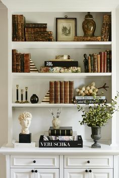 shelf styling inspiration.  Love the mix of old and new books!