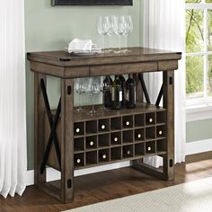Features: -Lets you entertain friends and family from the comfort of your own home. -When more serving space is needed, expand the item with the 3 extension leaves. Product Type: -Bar cabinet. Sty