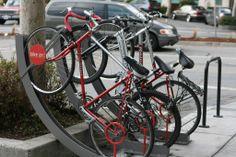 Neat bike rack for saving sidewalk space by Rac Arc – The Fab Web Bicycle Stand, Bicycle Rack, San Francisco Bus, Bike Locker, Bike Shelter, How To Clean Furniture, Furniture Cleaning, Urban Furniture, Metal Furniture