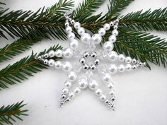 Tree decoration: other - pearl star white / silver, No. 8 - 8 cm - a design . Tree decorations: Other – pearl star white / silver, No. 8 – 8 cm – a unique product by Beads Beaded Christmas Ornaments, Christmas Snowflakes, Christmas Crafts, Christmas Decorations, Tree Decorations, Alcohol Ink Crafts, Hand Embroidery Flowers, Bead Crafts, Beading Patterns