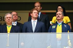 Prince Harry (C) and Brazil Minister of Sport Aldo Rebelo (R) look on during the 2014 FIFA World Cup Brazil Group A match between Cameroon and Brazil at Estadio Nacional on June 23, 201
