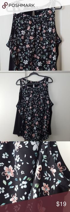 Torrid size 3 floral sleeveless top Cute floral on the front, black knit on bact. Worn once, no pilling, rips, snags or tears! Comes from a clean, smoke free home. torrid Tops Blouses