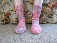 Here is a wonderful pair of hand knit adult size socks. The color is Cherry Blossom. Heel to toe is approx. 9 in. and the ribbing on the top (top to ankle) is approx. 7 in. These socks are made of 98% acrylic yarn, 2% polyester and are thicker then the other socks I have up for sale because they are made out of different material. They can be machine washed and dried.