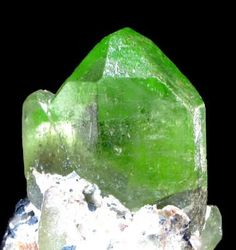 1 raw peridot- peridot is one of the few gemstones that is only found in one color: various shades of green. The intensity of the green hue depends on the amount of iron contained in the stone, and the best colored peridot contains less than 15% of iron.