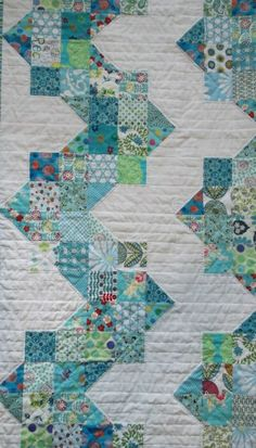 Such a pretty, peaceful quilt, I like the horizontal quilting; its hand-quilted.