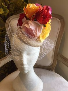 Cream button base fascinator with various flowers and cream netting. Gorgeous on! by CanteringDesigns on Etsy