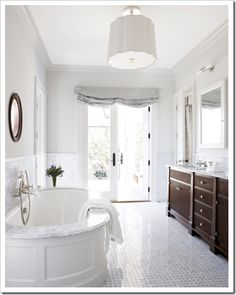 (just like white kitchens) I prefer mostly white finishes in bathrooms. They are clean and beautiful and if they are the ones that make it into magazines, consider that it may be a more timeless alternative for your home.