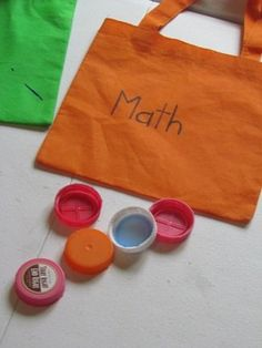 I found these bags at our local Dollar Tree. They were 2 for $1.oo each and I knew that they would be perfect for our take home math bags...    A math bag was sent home with each child.  We added each child's name on their bag