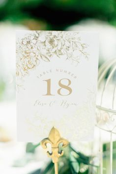 Chic wedding reception table number idea; photo: YourDreamPhoto