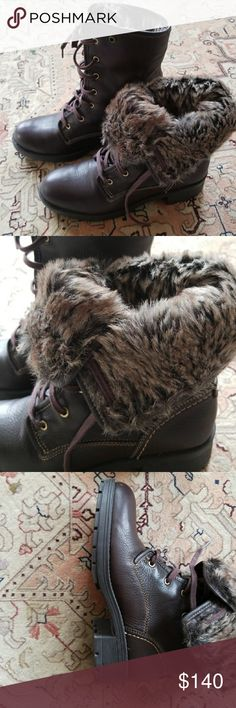 Clark's Artisan reunite GTX Winter boots. Top quality. Wore less than 5 times they just don't fit me. They are extremely warm and perfect for winter . Dark/chocolate brown . 'Fur' comes half way . The foot bed is lined with fabric (Not fur) Clarks Shoes Winter & Rain Boots