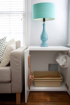 Why would you ever want a gross cat litter box sitting in your living room for all your guests to smell. can also put air freshener on side or top