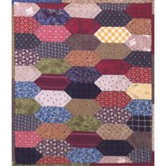 """Elongated Hexagon Little Things Wall Hanging  The Little Things Elongated Hexagons wall hanging measures approx 12"""" x 14"""". Featuring the Elongated Hexagon shape, this wall hanging is a great project for using scrap fabric and practicing your English Paper Piecing technique. Pattern includes: 100 x 2"""" Elongated Hexagon pre-cut papers 1 x 2"""" Elongated Hexagon acrylic template"""