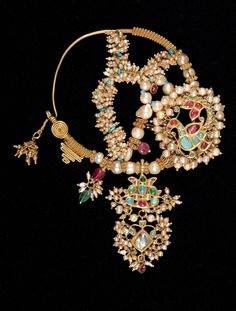 A gold Nath; a traditional nose ring, set with rubies, turquoise, and pearls. India Jewelry, Gold Jewelry, Jewelery, Bridal Jewelry Vintage, Antique Jewelry, Nose Ring Jewelry, Nose Rings, Nose Ring Designs, Nose Jewels