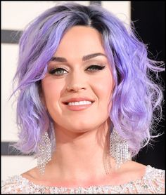 Katy Perry wore her signature cat eyeliner to last nights Grammy's but shook things up a bit with her violet locks. Thoughts? Love her winged eyeliner? Get it with our cat eye stencil. #celebrity #makeup #katyperry
