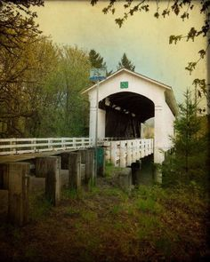 White Covered Bridge, Oregon Photography, old building photo, blue, yellow vintage inspired home decor print, wall art - 8x10. $30.00, via Etsy.