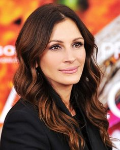 """Reddish-brown eyes are amplified by auburn highlights, as evidenced by Julia Roberts' latest hair hue. To further accentuate warm brown eyes, Goodwin says a muted plum shadow (like the one Roberts wore to the New York premiere of Eat Pray Love, left) can work wonders. """"Cool aubergine tones against reddish-brown eyes make the warmth of the eye appear even warmer,"""" she explains."""