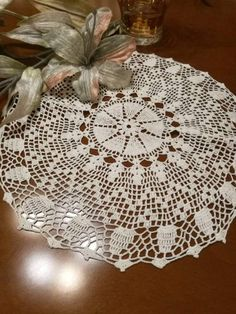 Check out this item in my Etsy shop https://www.etsy.com/listing/515727655/white-crochet-lace-doily-tabletopper