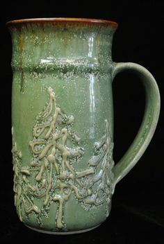 sage colored mug...love the brown at the rim. :o)   I love this piece of pottery!  Would buy in a heartbeat!