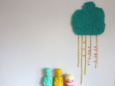 At home: plastic dolls in fabric rain.