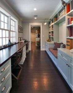 Absolutely love this breezeway / hall with shelves, storage, bench, dual desks, and lots of windows!!!