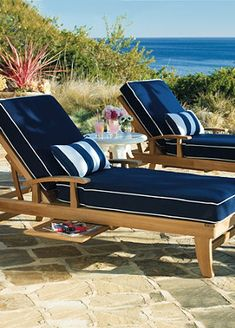 Navy and striped pillows create a timeless look for your patio furniture.