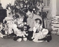 In this old Christmas picture from 1951 you can see our Ideal Toni doll's dress hanging on the rack to the left of my sister. Behind me are the Cass trunks we received for our Toni dolls. Our Toni dolls don't appear in this photo and were probably in the trunks.