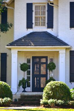Beautiful White Brick Exterior Home Pictures and Ideas - House & Living Portico Entry, Entry Doors, Exterior Brick, Wood Storm Doors, Front Porch Design, Front Entry Doors, House Front, Garage Door Design, House Exterior