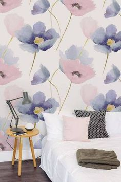 Wallpaper featuring oversized watercolour florals. Bedroom design/styling ideas with white, pink and grey