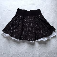 Black Lace Skirt Black lace skirt with white underneath. Has been worn but no flaws. Joe Benbasset Skirts Mini