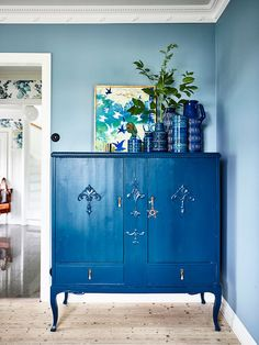 Fifty shades of blue - French By Design // Cobalt blue armoire, blue walls, blue west German pottery collection